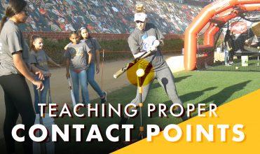 Sam Fischer teaching proper contact points using a tee