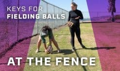 fielding balls at the fence